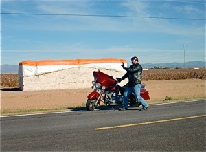 A Sanchin breaking from riding my H-D electra-glide, cotton fields, San Tan Valley, AZ 2011